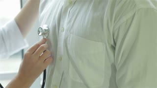 Close-up of a stethoscope on the patient's chest