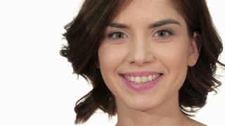 Closeup portrait of beautiful woman model face with skin foundation on white background