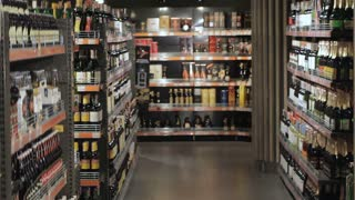 Couple choose alcohol at the hypermarket