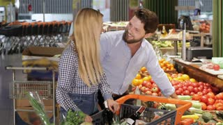 Couple choose vegetables at the supermarket