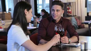Couple drink red wine at the restaurant