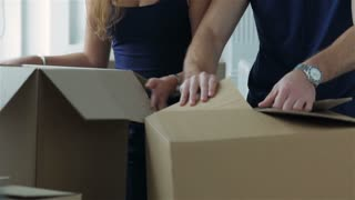 Couple girl and the guy looking at a box