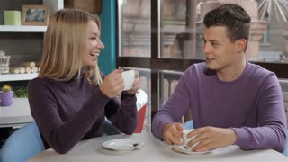 Couple has a pleasant conversation at the cafe
