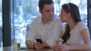 Couple have a date at the cafe