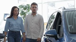 Couple looks inside the blue SUV