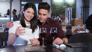 Couple make a selfie at the restaurant