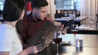 Couple view the restaurant menus