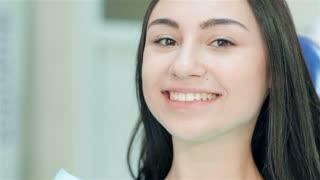 Cute girl teeth smile looking at camera
