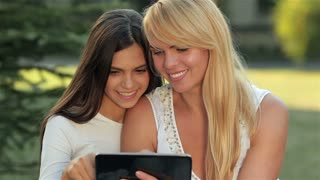 Daughter with her mother used a tablet