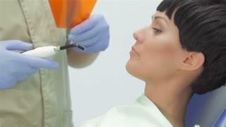 Dentist using ultraviolet photopolymer seal