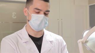 Dentist wears sterile gloves