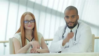 Doctor and patient showing thumb up
