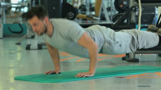 Doing push-ups and ends its program