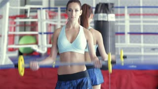During a workout, a young girl athlete it is her instructor