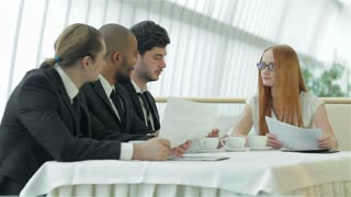 Female boss meets for colleagues