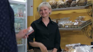 Female seller uses the credit card of the client for payment