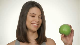 Girl holds green apple