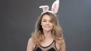 Girl spins with bunny ears on head