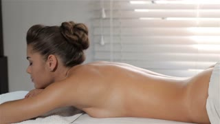 Girl turns her face on massage table