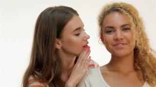 Girlfriend whispers in his ear