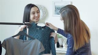 Girls choose dresses on sale