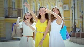 Girls-shopaholic emotionally rejoice in the street