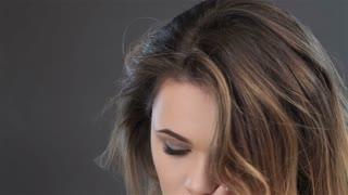 Gorgeous female model touches lips