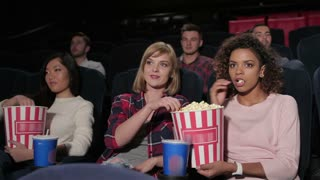 Group of young people sitting in multiplex