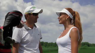 Instructor ask question to the female player about golf