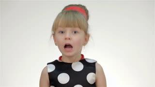 Kid girl screams on white background