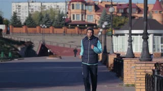 Male runner engaged in physical exercises outdoors