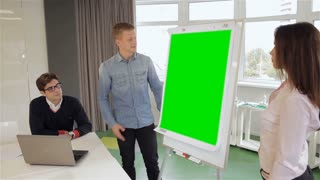 Man and woman show something on flipchart