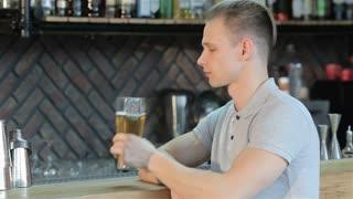 Man cheers at the bar