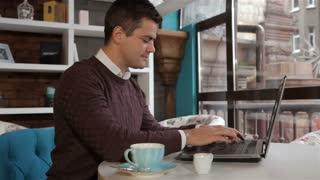 Man finishes to work on laptop