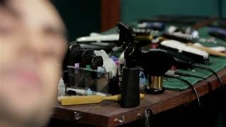 Man hairdresser doing haircut beard adult men in the men's hair salon