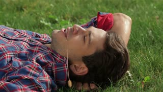 Man in the park lying on the grass