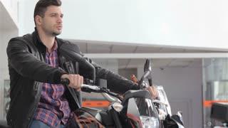 Man poses on motorbike