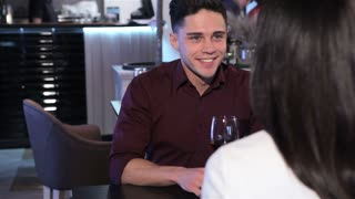 Man tells something to his woman at the restaurant