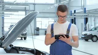 Mechanic types on tablet