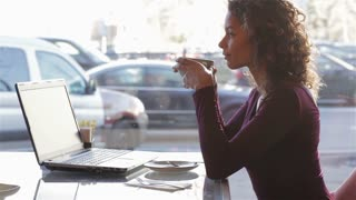 Modern pretty woman having breakfast or lunch