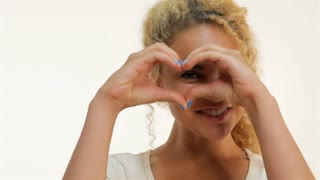 Mulatto woman showing heart shape gesture