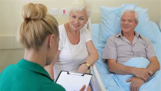 Nurse notes the state of health of senior male patient