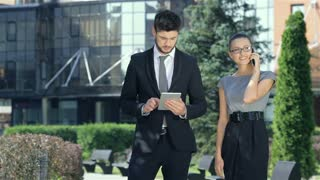 Сouple standing together, work on the tablet, gets good performance
