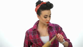 Pin up girl look on wristwatch