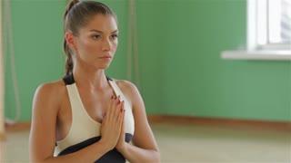 Portrait of serene girl doing yoga exercise in gym