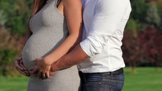 Romantic moments for pregnant couple