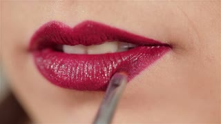 Sexy woman lips with red makeup and gloss