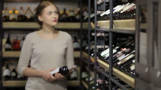 Shopping in the supermarket, wine shelves