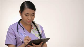 Smiling Asian nurse with clipboard