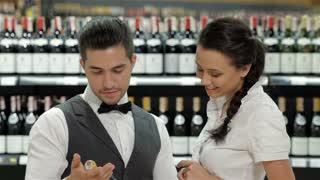 Sommelier giving woman recommendation